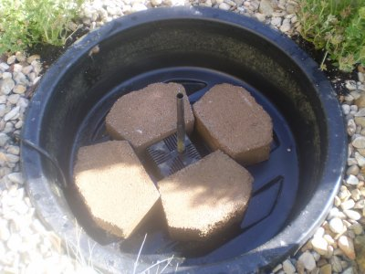 How to build a pebble fountain for Fountain pond liners